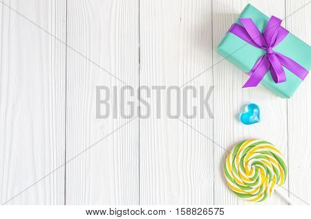 birth of child - lollipop on wooden background top view