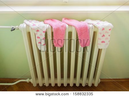 Wet socks drying on a hot radiator