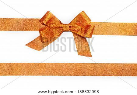 Golden horizontal gift ribbons and luxurious bow isolated on white background