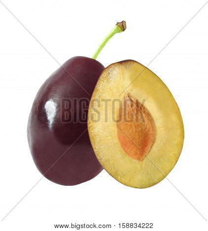 whole and cut in half plums isolated on white background with clipping path