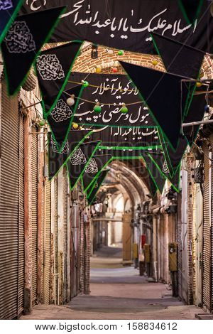 Tabriz, Iran - December 4, 2015: Old Bazaar of Tabriz with black flags during Ashura in Iran.