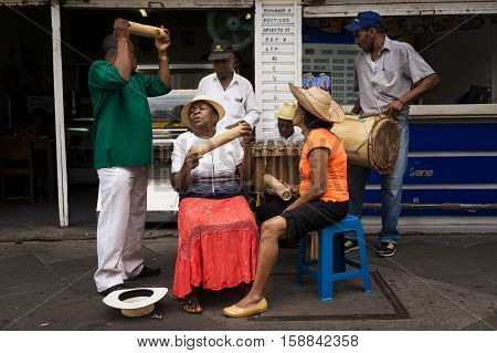 Cali Colombia - February 6 2014: Street musicians playing in a street in the city of Cali in Colombia