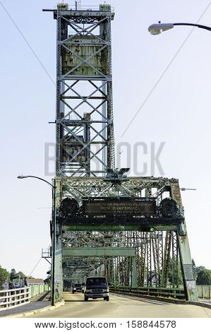 Portsmouth New Hampshire USA - August 9 2009: World War I Memorial Bridge between Portsmouth New Hampshire and Kittery Maine before the center span was demolished in 2012 and a new span built in its place