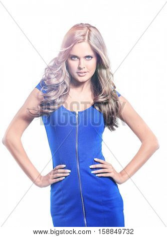 young woman in blue dress posing in studio