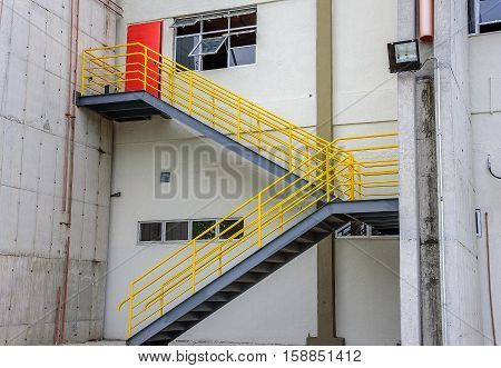 At the cargo terminal in the old Galeao airport where all-cargo aircraft usually park, white building, ladder with yellow railing and red door. Rio de Janeiro, Brazil