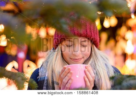 Friendly Young Woman Enjoying A Hot Beverage