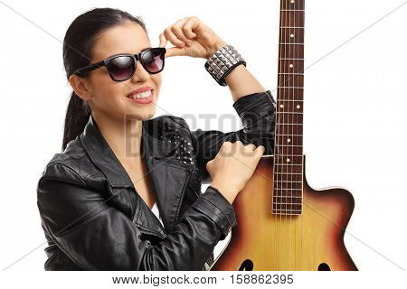 Portrait of a young woman posing with an acoustic guitar isolated on white background