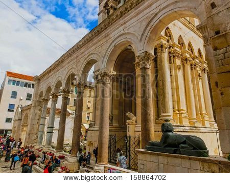 Split, Croatia - May 08, 2014: Tourists walking at the Diocletian's Palace in Split, Croatia. It is well preserved and important popular touristic attraction of Dalmatia on a cloudyday on May 08, 2014