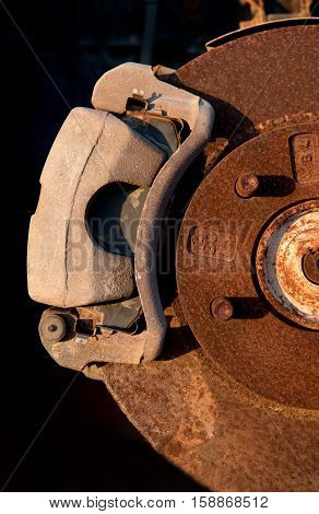 Details of parts of a rusty car wheel brake