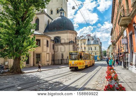 Lviv Ukraine - August 15 2016: Tram is in the historic center of Lviv on the corner of Market Square near Latin Cathedral