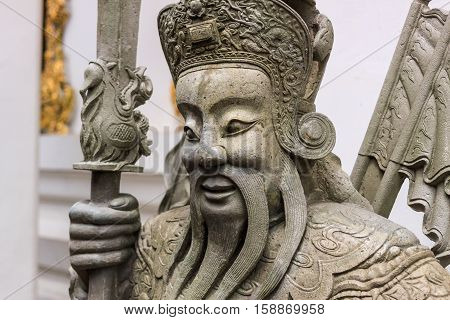 Ancient Chinese warrior statues in temple of Thailand