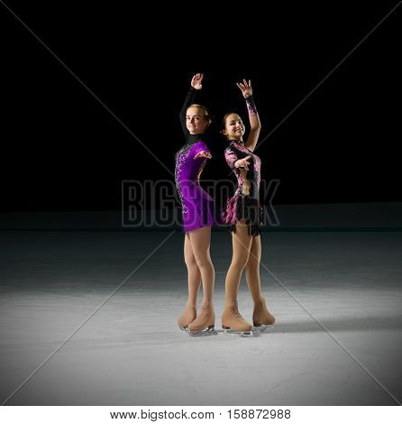 Young girls figure skaters (on ice arena ver)