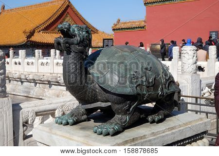BEIJING, CHINA - FEBRUARY 23, 2016: Bronze turtle in the imperial palace which stands for power and long life, Forbidden city in Beijing, China on February 23, 2016.