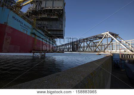 ESBJERG DENMARK - NOVEMBER 27 2016: Closeup bridge from harbor to oil rig
