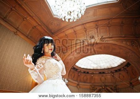 Cute Brunette Bride Posed On Rich Royal Palace.