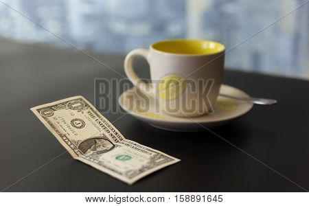 concept of a dollar tip on a dark table with a blurred background