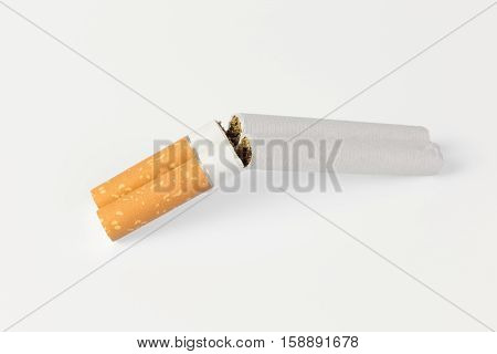 two cigarettes in a refracted shotgun on a white background