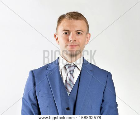 Businessman wearing a three piece blue  suit and tie