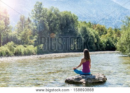 serenity and yoga practicing at the river. Slovenia
