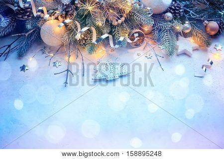 Christmas Tree Pine Branches and Christmas balls on the snow