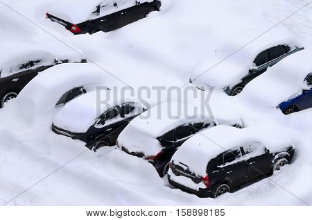 Snow covered car parking lot
