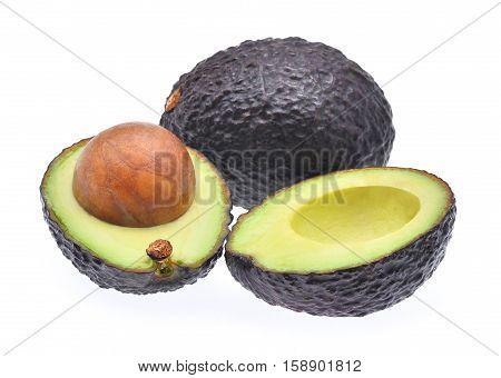 fresh avocado with slice isolated on white background
