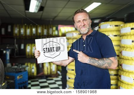 Car Parts Shop Owner Holding Placard Warehouse Startup Concept