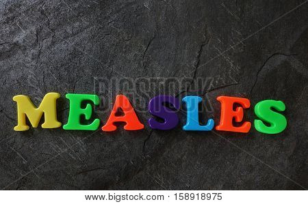 Measles spelled out in colorful play letters