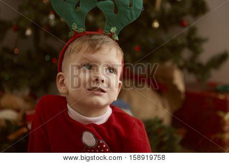 Young boy in deer antlers