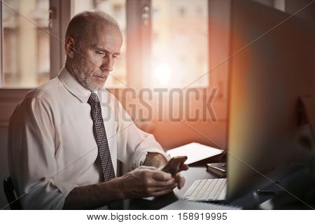 Businessman working until the sun sets