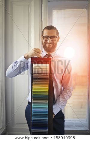 Guy showing color samples