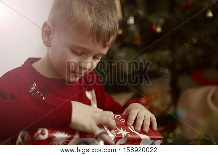 Child looking inside his present