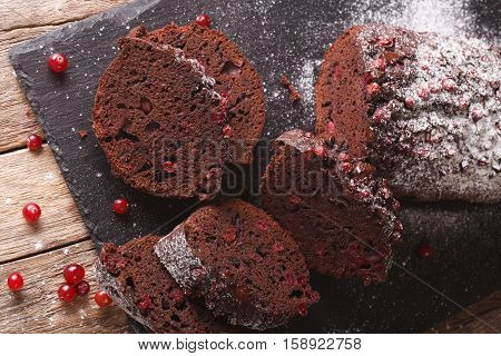 Sliced Chocolate Pie Stuffed With Cranberries Close-up. Horizontal