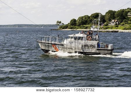 Portland Maine USA - August 9 2009: Coast Guard vessel crossing Casco Bay near Portland Maine