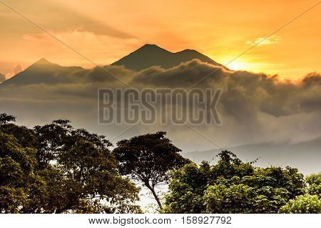 Fuego & Acatenango volcanoes at sunset outside Spanish colonial town & UNESCO World Heritage Site of Antigua in Panchoy Valley, Guatemala, Central America
