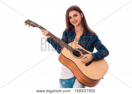 cheerful Brunette girl playing guitar and smiling on camera isolated on white background