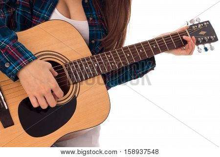 close up of girl tunes the guitar isolated on white background