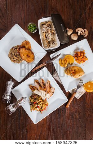 Set the table with different dishes taken from above