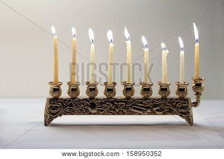 The Symbols of Hanukkah - nine-branched mehorah Hanukiah