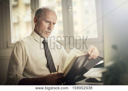 Businessman organising his notes