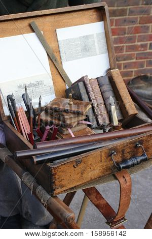 26TH NOVEMBER 2016, PORTSMOUTH DOCKYARD, ENGLAND:  A writers books and equipment at the christmas victorian festival in portsmouth dockyard, england, 26th november 2016