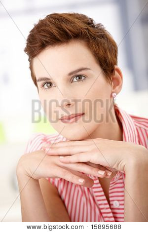 Closeup portrait of daydreaming redhead woman posing.?