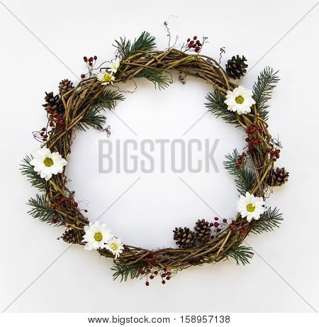 Festive Wreath Of Vines Decorated With Berries, Fir Branches, Daisy Flowers And Cones. Flat Lay, Top