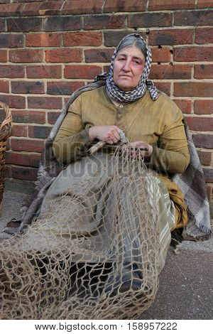 26TH NOVEMBER 2016, PORTSMOUTH DOCKYARD, ENGLAND: An unknown actor playing the part of a victorian woman at the yearly Christmas victorian festival in portsmouth dockyard,england,26th november 2016