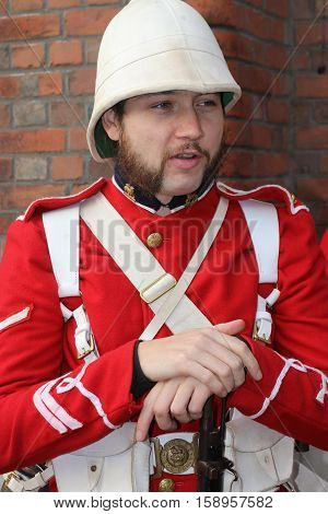 26TH NOVEMBER 2016, PORTSMOUTH DOCKYARD, ENGLAND:An unknown actor playing the part of a victorian soldier at the yearly Christmas victorian festival in portsmouth dockyard,england,26th november 2016