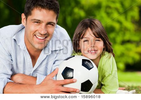 Father and his son with their ball in the park