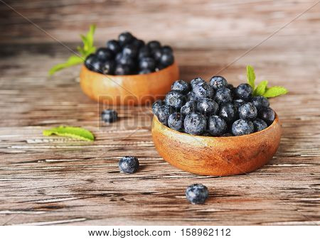 Fresh Bilberries Or Blueberries In Small Wooden Bowls, Selective Focus