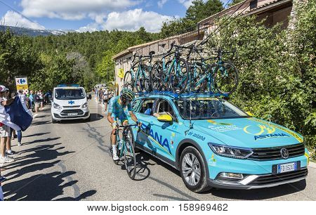 Mont Ventoux France - July 142016: The Italian cyclist Diego Rosa of Team Astanadiscussing with the team staff while riding on the road to Mont Ventoux during the stage 12 of Tour de France 2016.
