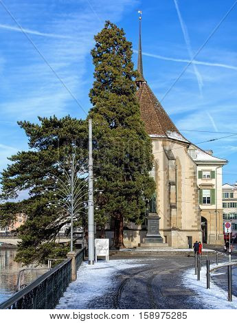 Zurich, Switzerland - 18 January, 2016: the Water Church, view from Limmatquai quay. Zurich is the largest city in Switzerland and the capital of the Swiss Canton of Zurich.