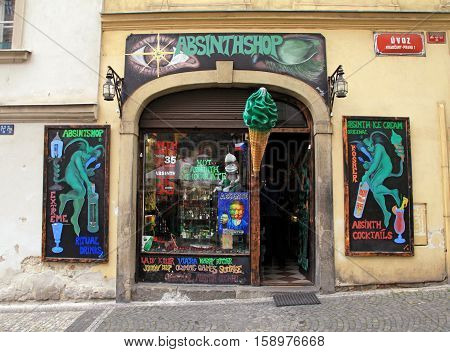 PRAGUE, CZECH REPUBLIC - SEPTEMBER 30, 2015: Entrance of vintage absinthshop that sells Absinthe also known as Green Fairy in Prague's Old Town Prague Czech Republic